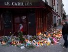 MOURNING: A man stands in front of the memorial outside the Le Carillon cafe in Paris where one of the attacks took place.