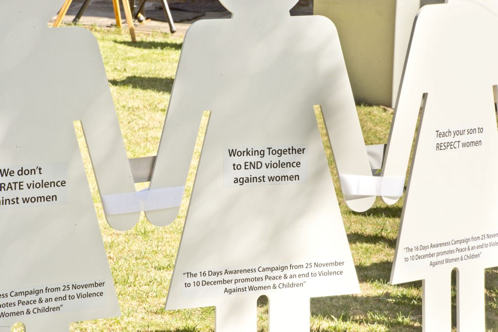 White cutouts signify women killed through domestic violence.