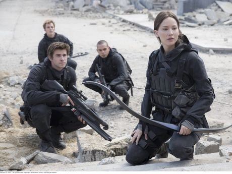 Sam Claflin, Liam Hemsworth and Jennifer Lawrence in a scene from the movie The Hunger Games: Mockingjay - Part 2.