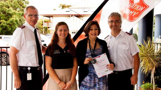 Left Lieutenant David Godkin (STH QLD Divisional Commander), Madeline Agnew (Caloundra Youth worker), SCILS student Emma McLean (with her Silver Award and certificate) and Captain Stuart Glover (Caloundra Salvation Army Officer).
