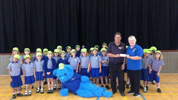 BIG BLUEY: Fundraising Officer with Westpac Life Saver Rescue Helicopter, John Bancroft accepting the schools support along with students and Big Bluey of Summerland Christian School.