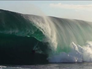 Bodyboarder's death-defying run in giant barrel