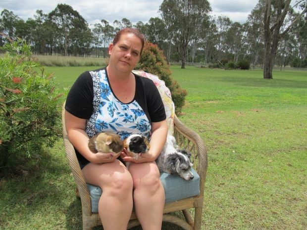 PET DUMPING NOT OKAY: Animal lover Alina Briggs with her pet dog and guinea pigs.Photo Contributed