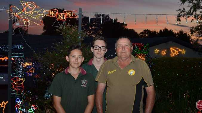 LIGHTING UP THE SKY: Geoff Hartwig with grandsons Jackson and Harrison Lucas. Photo Rhiannon Tuffield / South Burnett Times