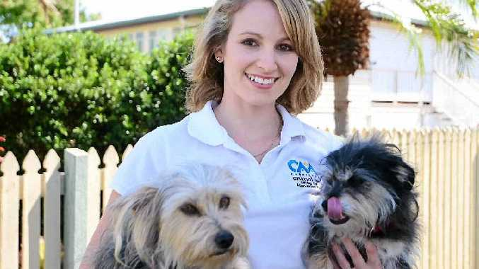 HOMES NEEDED: Capricorn Animal Aid president Katina Kilpatrick with two rescue pups.