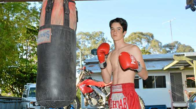 16-year-old John Robinson training at home in the shed while in Australia.