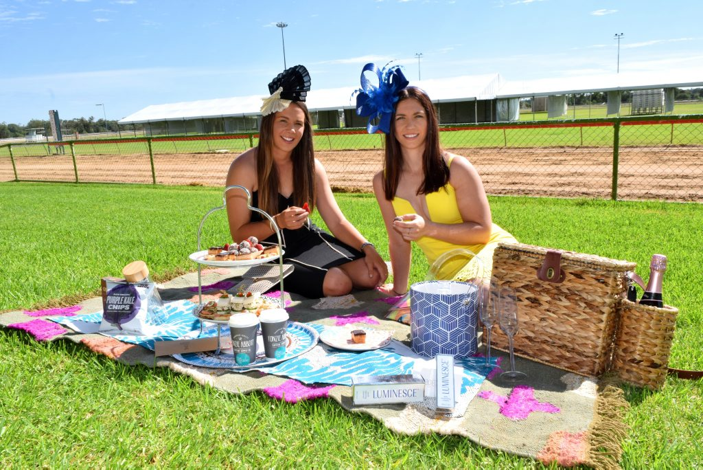 HIGH FASHION: Roma sisters Jane and Shel Rowbotham, seen here surrounded by products from key sponsors, want to see locals turning up to the Roma Cup this weekend. Photo Tom Gillespie / Western Star