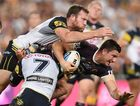 Broncos Andrew McCullough is tackled by Cowboys Gavin Cooper and Johnathan Thurston during the NRL Grand Final between the Brisbane Broncos and the North Queensland Cowboys at ANZ Stadium in Sydney on Sunday, Oct. 4, 2015. (AAP Image/Dean Lewins NO ARCHIVING, EDITORIAL USE ONLY