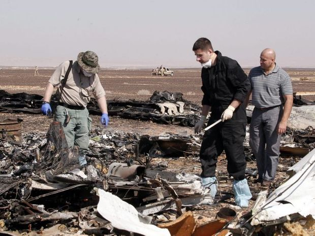 Russian investigators checking debris from crashed Russian jet at the site of the crash in Sinai, Egypt. EPA/KHALED ELFIQI