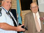 PROUD SERVICE: Superintendent Mark Stiles (left) presents retired Sergeant First Class Rex Allison with the National Police Service Medal. Sgt Allison retired in 1980 after serving at Roma Street, Maryborough, Nanango and Gympie.