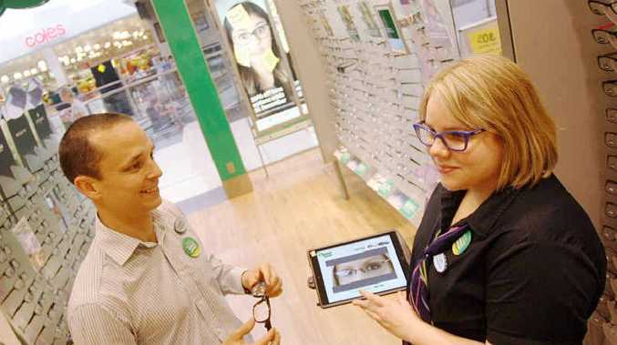EYE CARE: Specsavers Craig Allom and Allison Noble discuss the range of optical solutions available at their store in Stockland Rockhampton. Photo Tamara MacKenzie / The Morning Bulletin