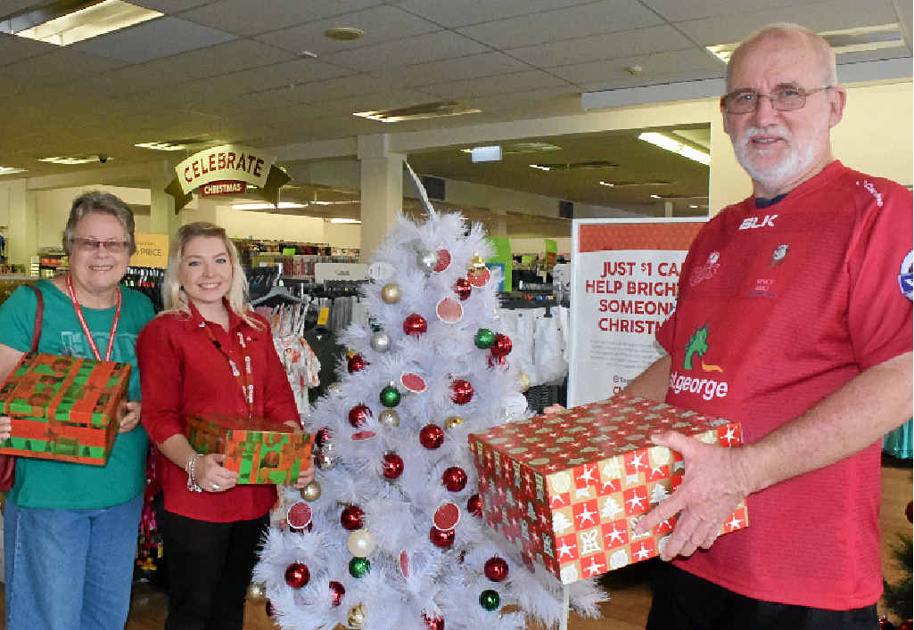 PLEASE HELP: Uniting Church's Rev Jenny Sims, Dalby Target assistant manager Monique Taylor and Greg McKay launch the Target and UnitingCare Christmas Appeal 2015.