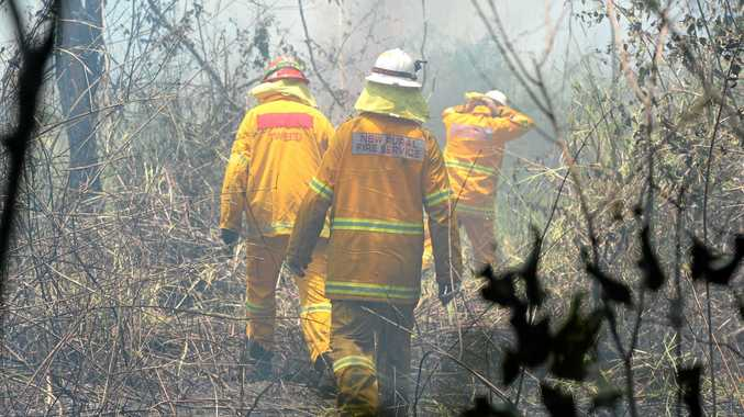 Rural Fire Service volunteers on the scene of a bush fire in the Tweed last year.