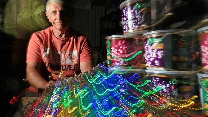 Stokers Siding resident, Mr David White takes time to sort through 158000 christmas lights prior to his annual Christmas light display.