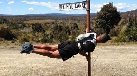 Jamie Milne takes a moment out from his personal ultra-marathon around Tasmania to act the goose by the side of the road.
