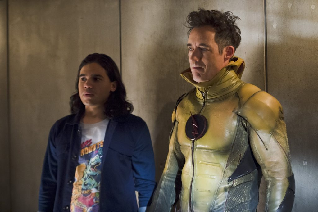 Cisco Ramon (Carlos Valdes) and Harrison Wells (Tom Cavanagh) in The Flash (Season 2, Episode 7)