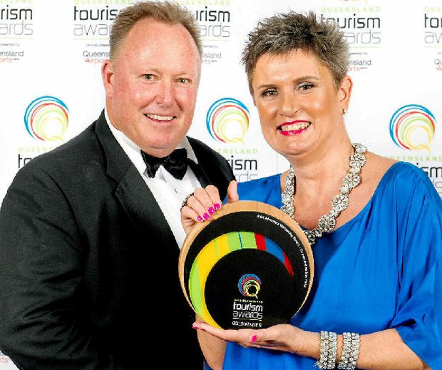 WINNERS ARE GRINNERS: BIG4 Adventure Whitsunday Resort owners enjoy their award.