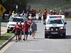 Employees leave the Bunnings in Airlie Beach earlier this afternoon.