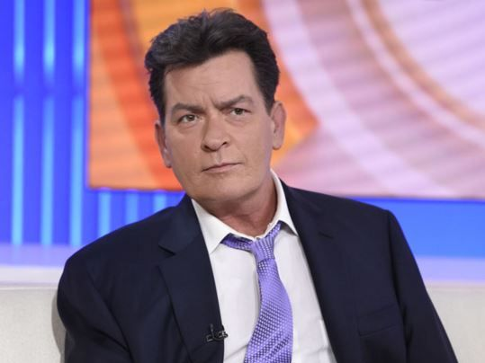 Charlie Sheen says he has paid out $10 million to try to keep his HIV status secret.