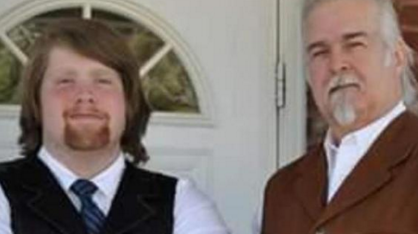 Thomas Riggs (l) stands with his father Anthony Riggs (r)