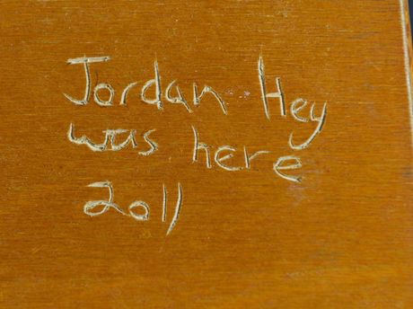 The desk that was signed by Jordan Hey in 2011. Photo: Rob Williams / The Queensland Times