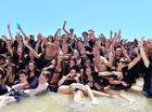 Crazy convoy of graduates hit the beach at Mooloolaba