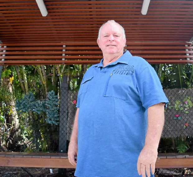 FED UP: Taxi driver Chris Owen is fed up as construction of the Airlie Beach taxi rank continues to meet delays.
