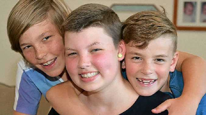 HOME AGAIN: Bella is welcomed home by her brothers Angus, 9, and Lewis, 8.