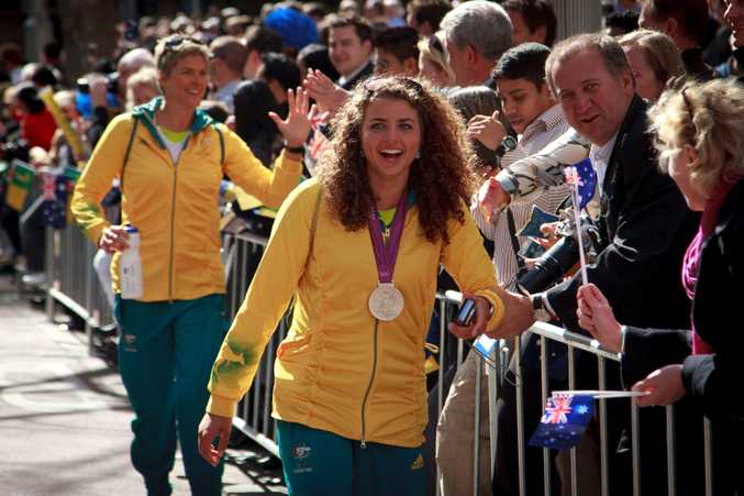 Happy homecoming ... Jessica Fox during the Australian Olympic Athletes welcome home parade in George Street, Sydney in August 2012. Photo: AAP Image/John Donegan.