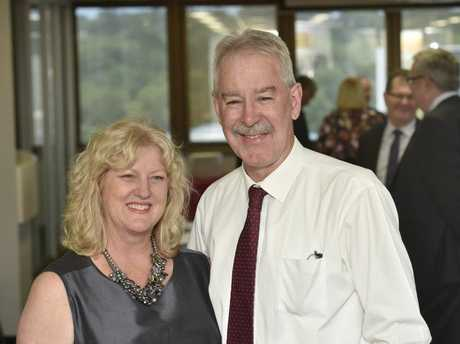John Minz, CEO, Heritage Bank with his wife, Lisa on his final day with the bank.