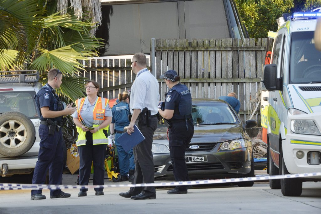 Police at the scene of a fatal traffic crash at Booval November 11, 2015.