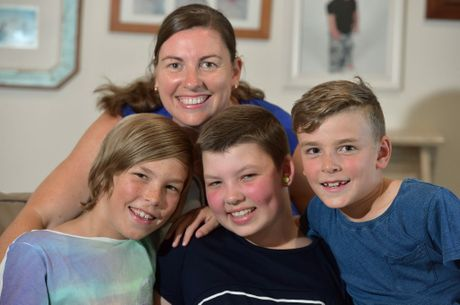 13-year-old Bella Harry is spending her first day back at home with her family after an 11-month battle with Cancer. Bella has already been hanging out with her brothers and catching up with friends. Bella is welcomed home by her mother Emma and brothers Angus,9, and Lewis,8. Photo: Warren Lynam / Sunshine Coast Daily