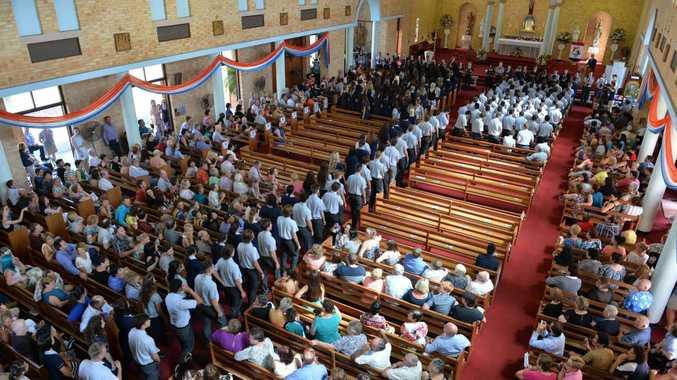 St Pats grade 12 students enter the church Photo Tony Martin / Daily Mercury