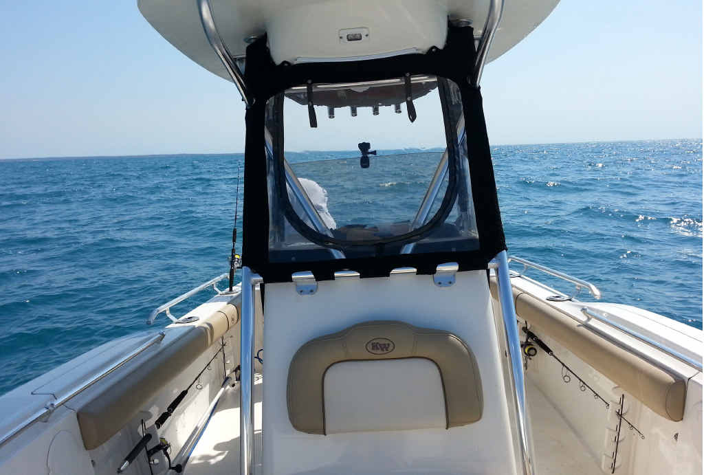 RELAXING BETWEEN STRIKES: Enjoying the comforts of fishing in a safe boat set up for offshore work.