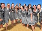 PERFECT DAY: Siena Catholic College students enjoy the moment at Mooloolaba beach after graduating from Year 12.