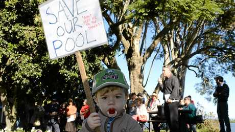 Over 100 Ulmarra residents turned out for the public meeting regarding their pool on Saturday at Bailey Park. Pictured at the meeting is Rocky Carter, 2, of Tucabia with his placard. Photo Debrah Novak / The Daily Examiner