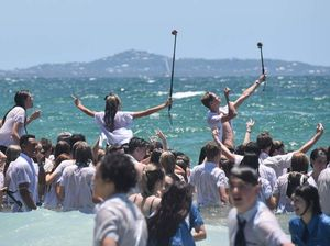 PHOTOS: Schoolies descend for a dunk at beach