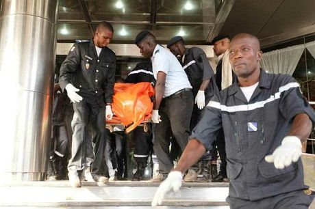 A body is removed from the Radisson Blu hotel, after it was stormed by gunmen during a attack on the hotel in Bamako, Mali,