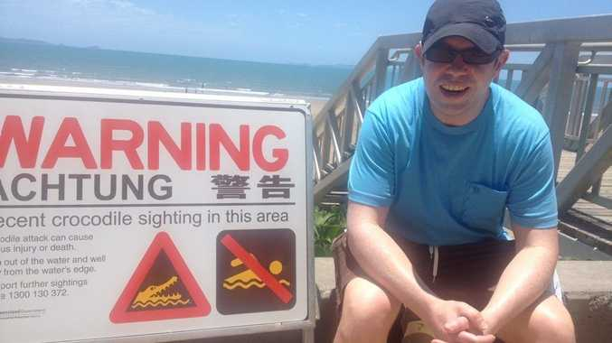 Uk visitor Alex Seal was looking forward to going for a dip in the sea at Yeppoon Beach when he saw the crocodile sign. Photo: Contributed