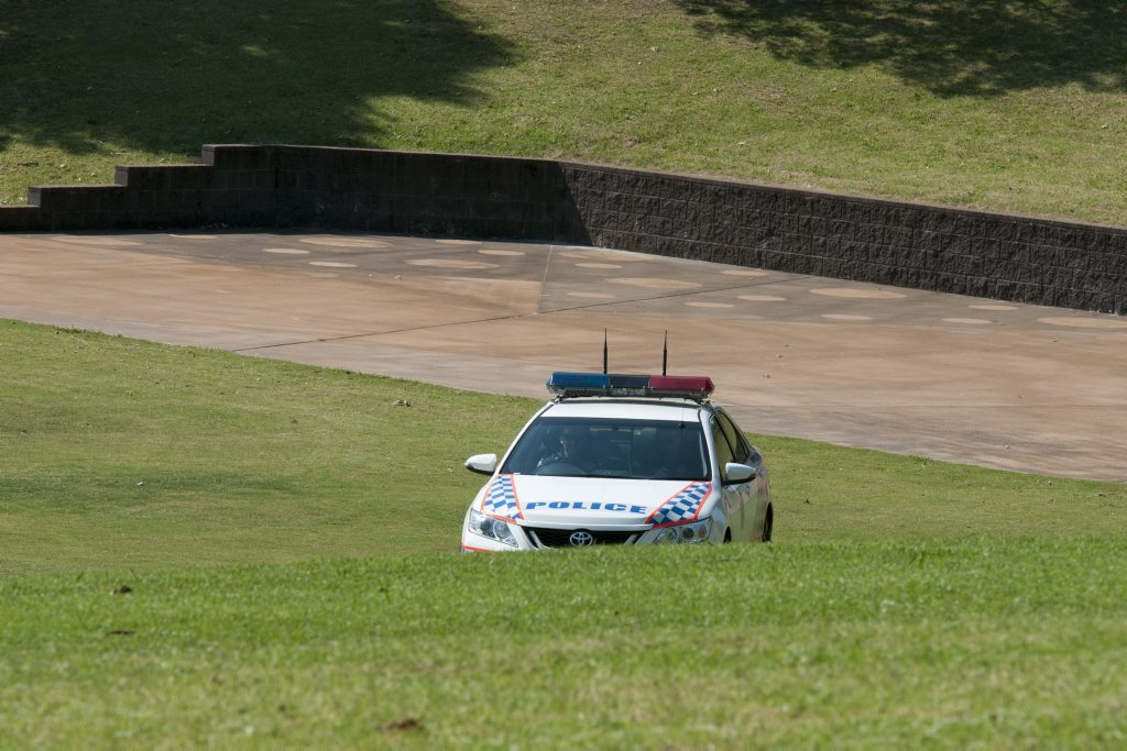 Police looking for a snake in Queens Park.