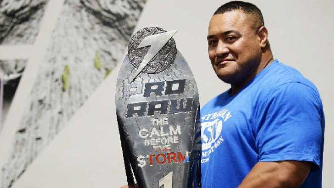 SUPER HEAVYWEIGHT: Odell Manuel shows off his latest trophy after being crowned Australia's strongest man.