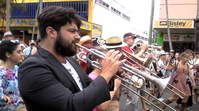 Festival Patron Harry Angus joined the brass section during the parade. Photo Ross Kendall / Northern Star