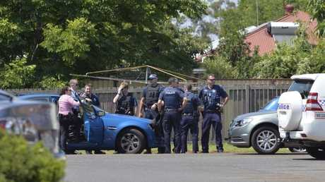 Police and detectives at Brim St, Newtown, after reports of a disturbance.