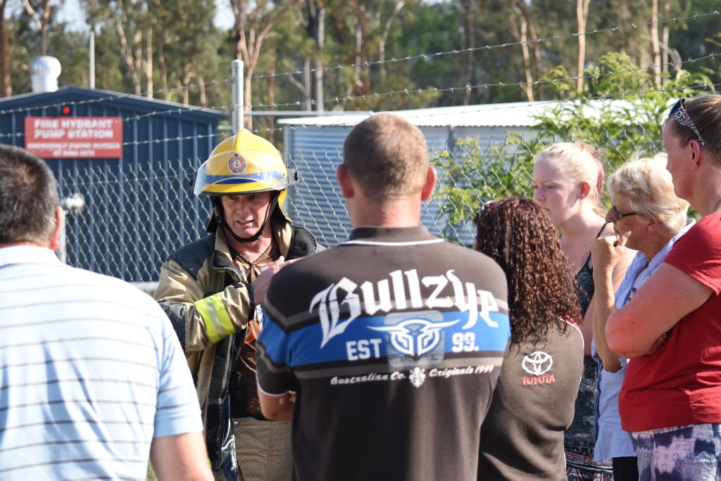 Fire fighters talk with family members of Anuha staff after a possible chemical spill at the Gatton plant. Photo Ali Kuchel / Gatton Star