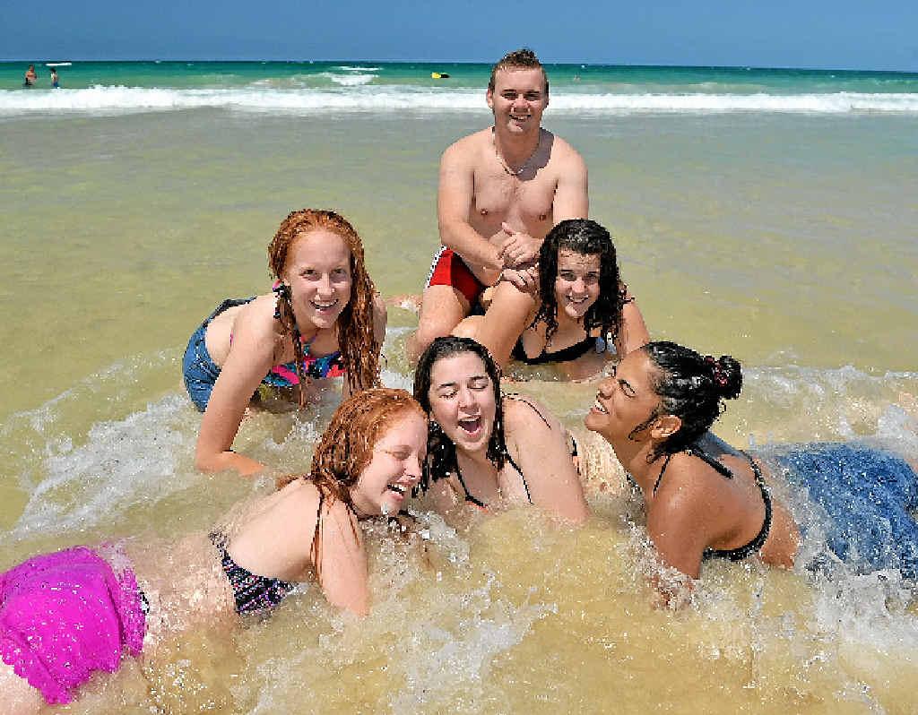 SCHOOLIES CHILL OUT: Taylib Lampton, Marnie Chapple, Joshua Salisbury, Mason Bulgarelli, Georgia Bulgarelli and Maddy Lydeamove-Walker cool off in the pristine waters of Rainbow Beach yesterday.
