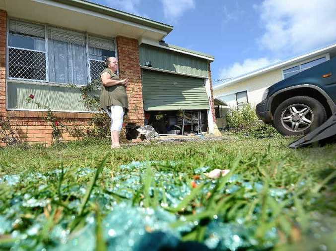 RUDE AWAKENING: Joanne Hancock, of Goonellabah, was woken with a shock when a car crash landed in her front yard on Sunday.