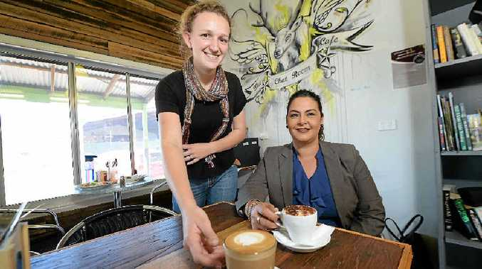 LAST DRINKS: Chat Room barista Laura Ross delivers two coffees to Karen Abrahams from Department of Youth Justice, one for her and one paid forward back in August. The cafe closed yesterday due to financial reasons.