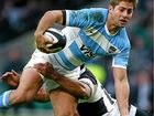 GIVEN THE SLIP: Argentina's two-try hero Santiago Cordero slips the tackle from Stephen Moore of the Barbarians during the Killik Cup match at Twickenham Stadium in London.