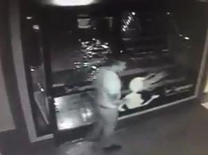 CCTV catches man punching glass door on Sydney St