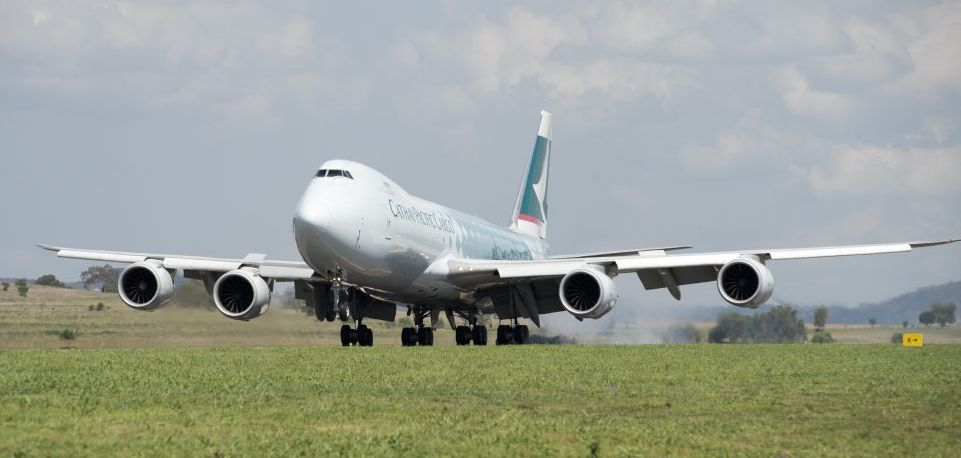 Cathay Pacific 747-8 jumbo cargo plane flies into Wellcamp Airport bound for Hong Kong.
